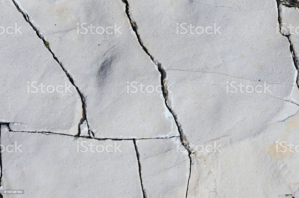Cracked stone closeup stock photo
