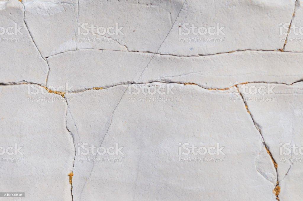 Cracked stone detail stock photo