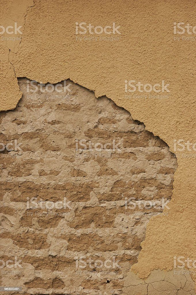 Cracked Wall With Underlying Brick, Grunge, Background, Texture, Warm Tones royalty-free stock photo