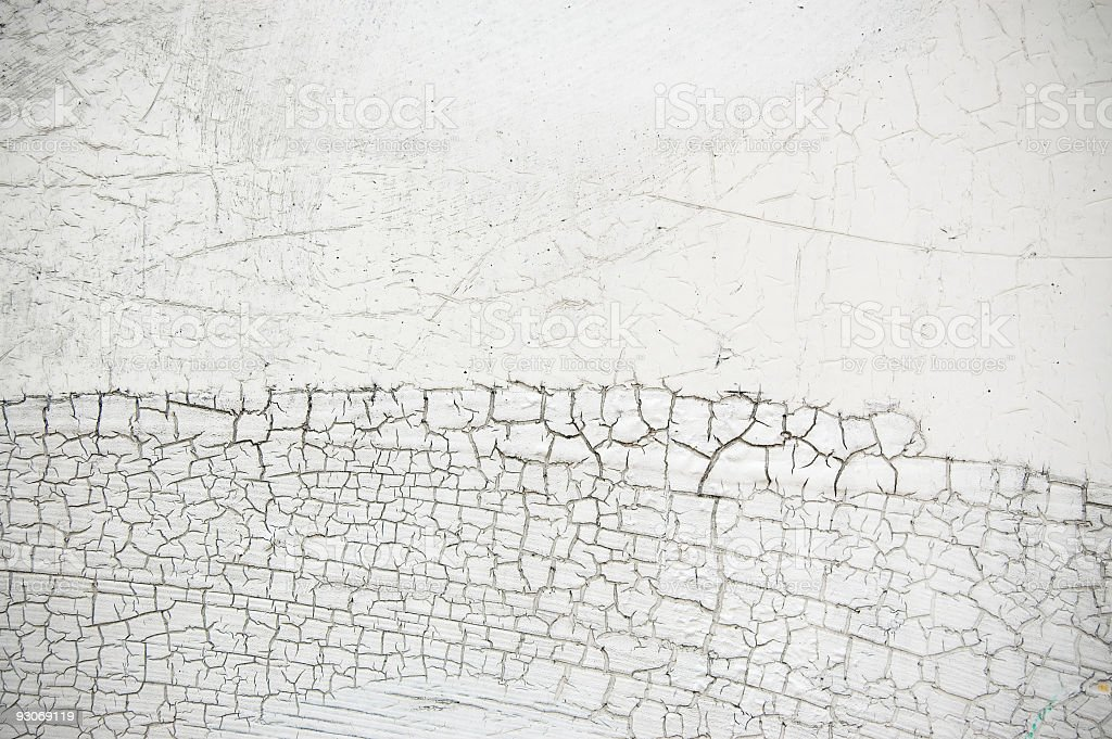 Cracked White Paint on Cement Wall royalty-free stock photo