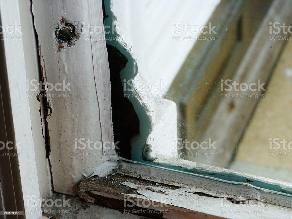cracked window close up detail filler diy stock photo