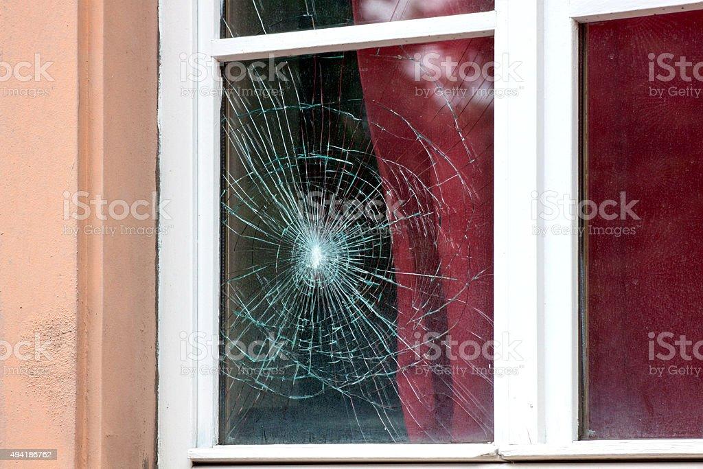 Cracked window stock photo