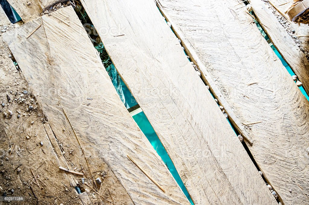 Cracked wooden floor stock photo