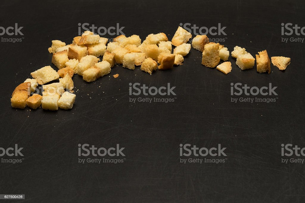 crackers on a black background bottom place for an inscription stock photo