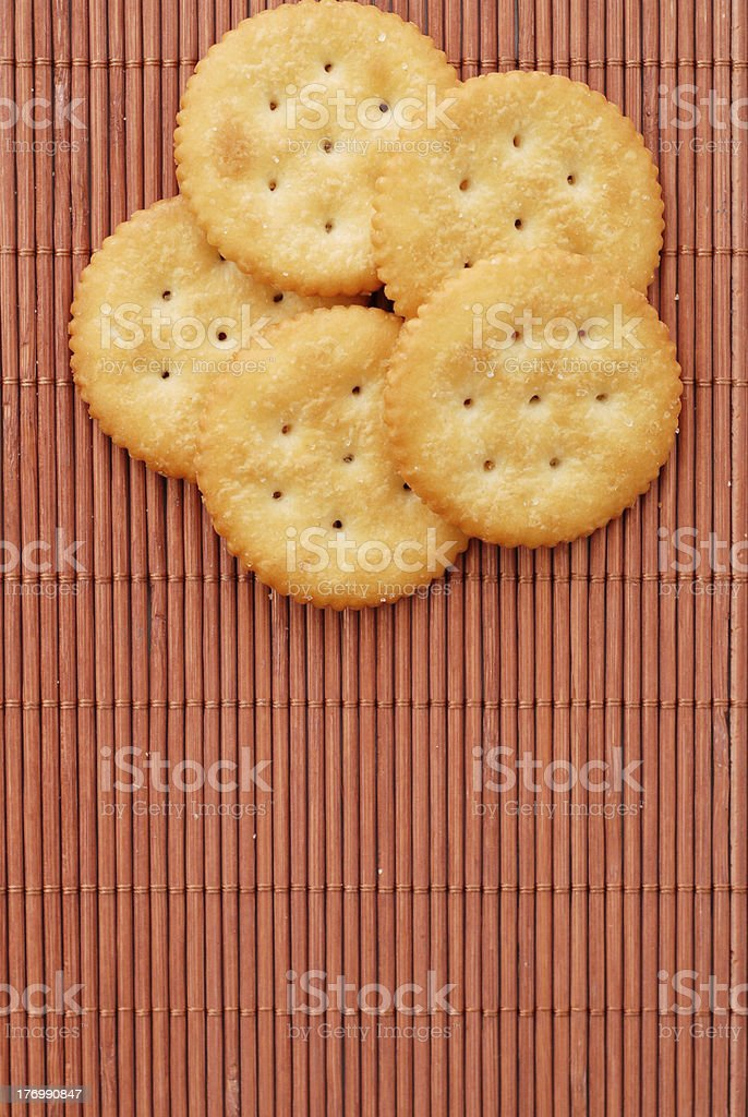 Crackers on Bamboo Mat royalty-free stock photo