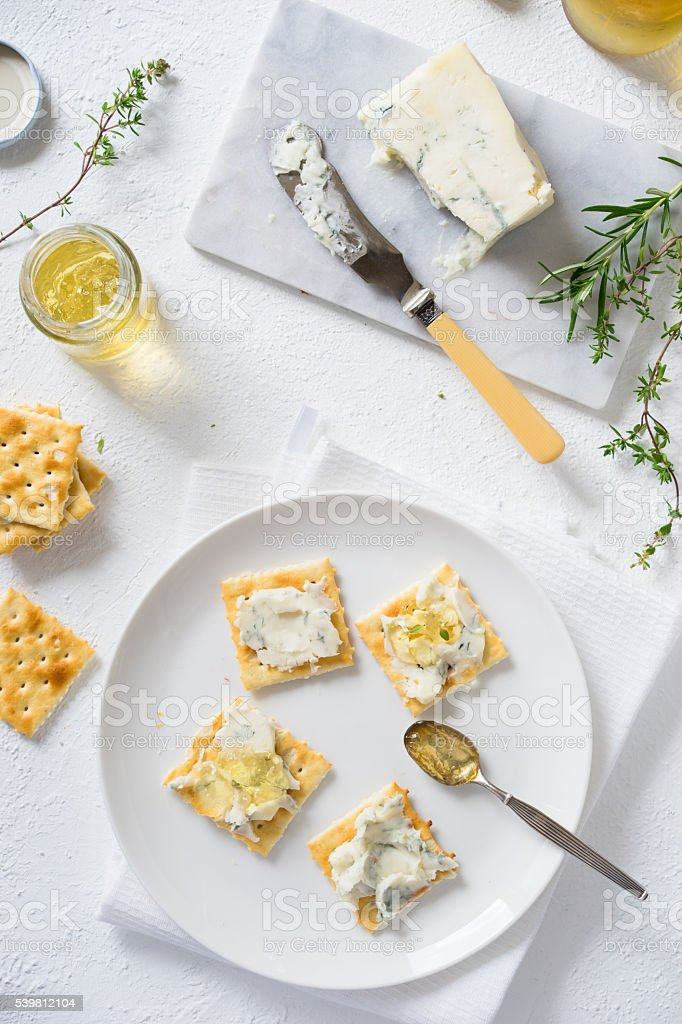 Crackers with gorgonzola and white wine jelly stock photo