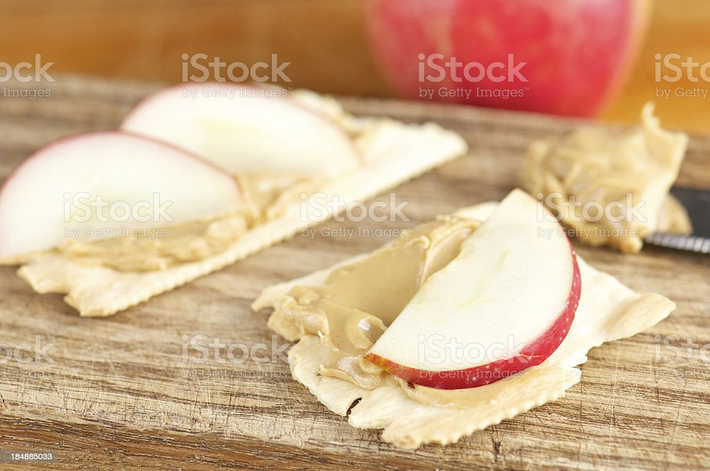 Crackers with Peanut Butter and Apple Slices stock photo
