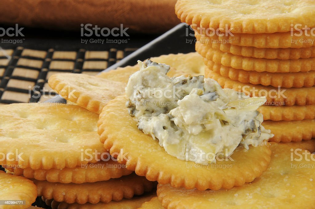 Crackers with spinach artichoke dip stock photo