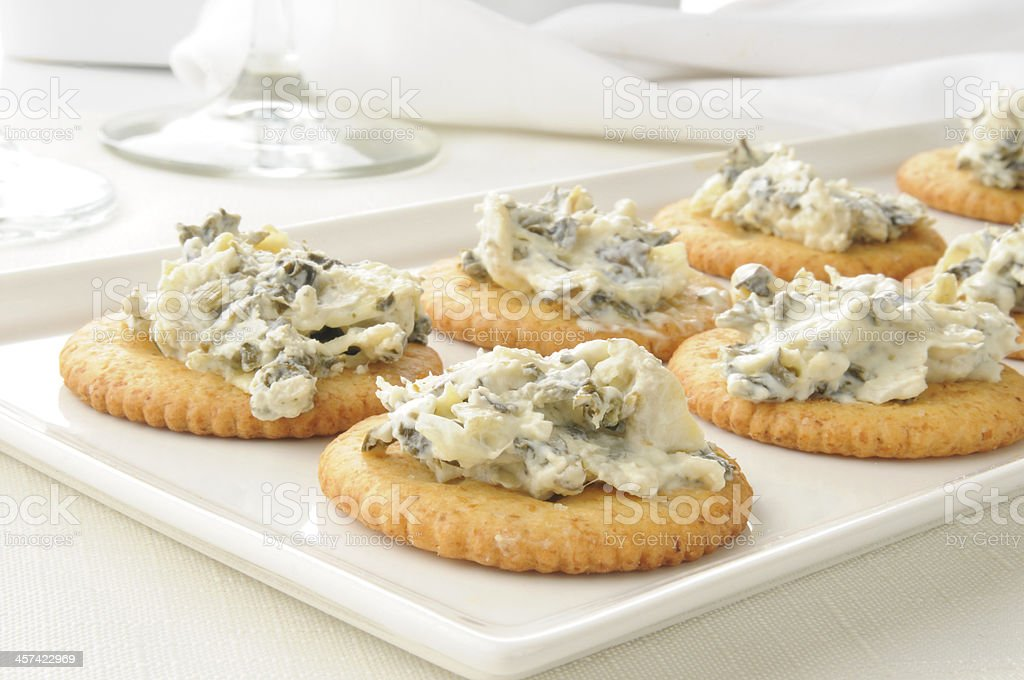 Crackers with spinach artichoke spread stock photo