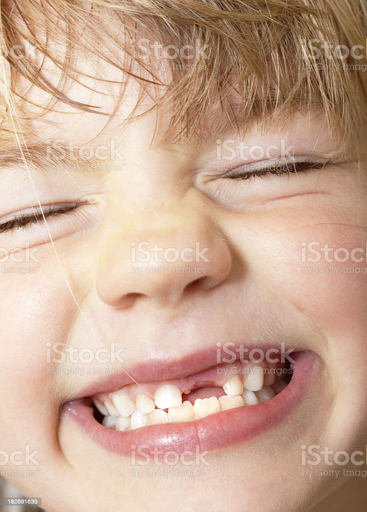 Cracking up - girl with super-cute grin stock photo