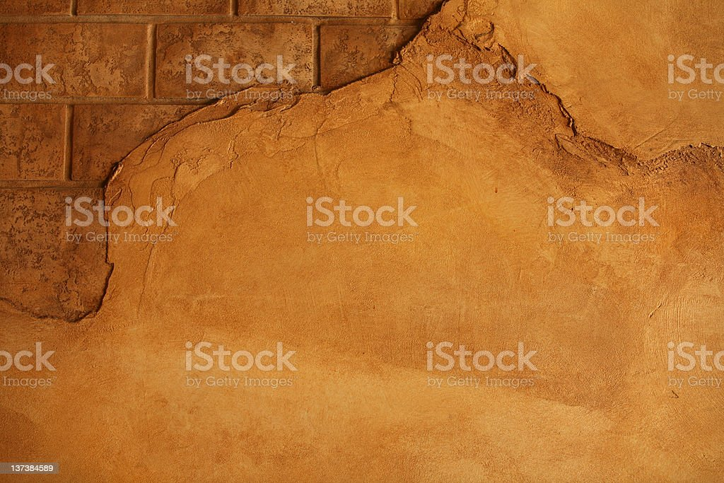 cracking wall with bricks showing royalty-free stock photo