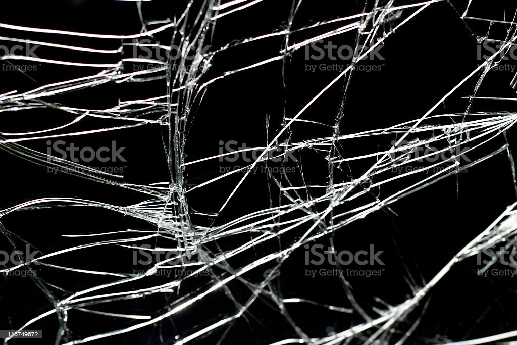 Cracks in broken windshield against a black background. royalty-free stock photo
