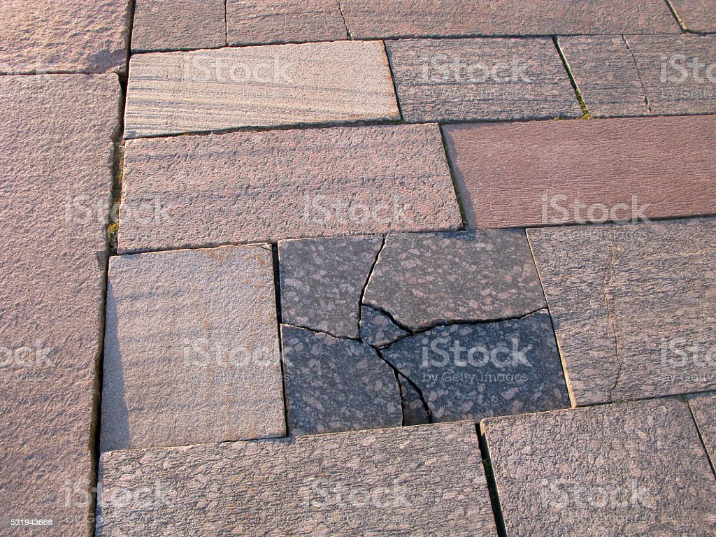 Cracks in street tile stock photo