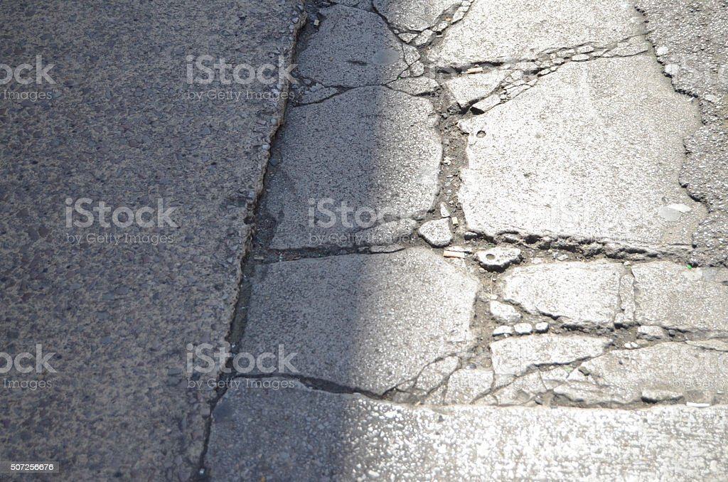 Cracks in the Damaged Pavement stock photo