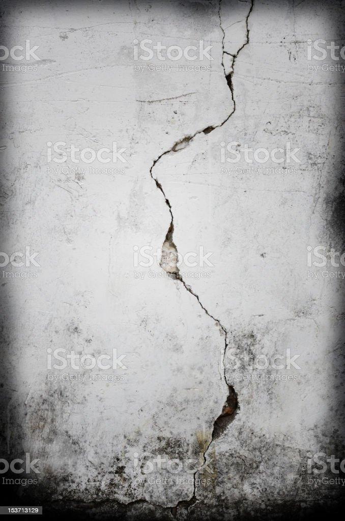 Cracks on grunge backgrounds stock photo