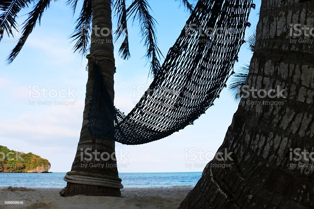 Cradle with coconut palms on the beach. stock photo