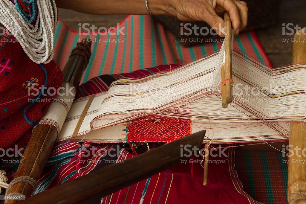 Crafmanship weave silk threads to cloth stock photo