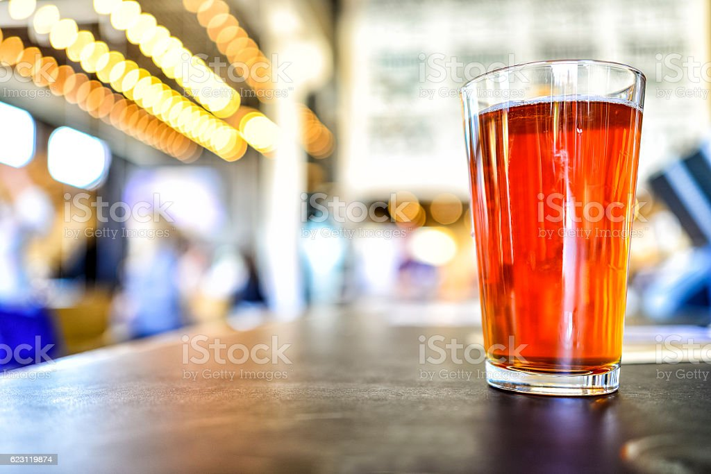 Craft Beer on Brewery Counter with Bokeh Lights stock photo