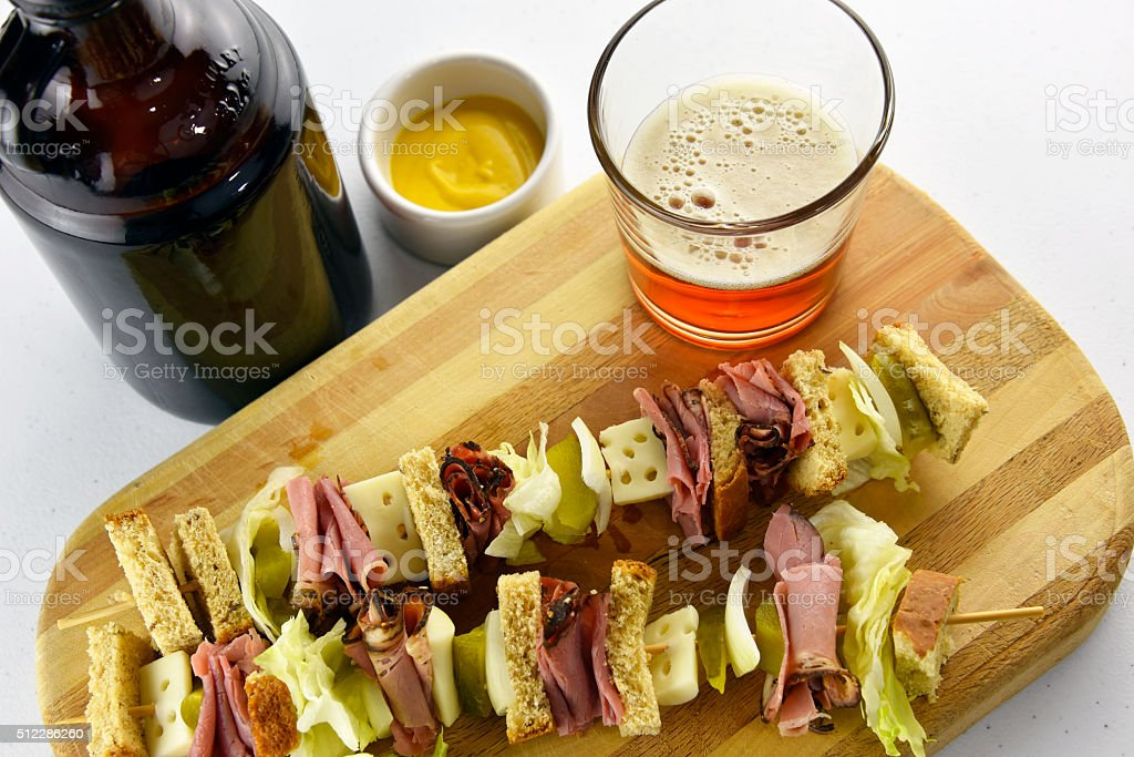 Craft Beer with Pastrami Sandwich royalty-free stock photo