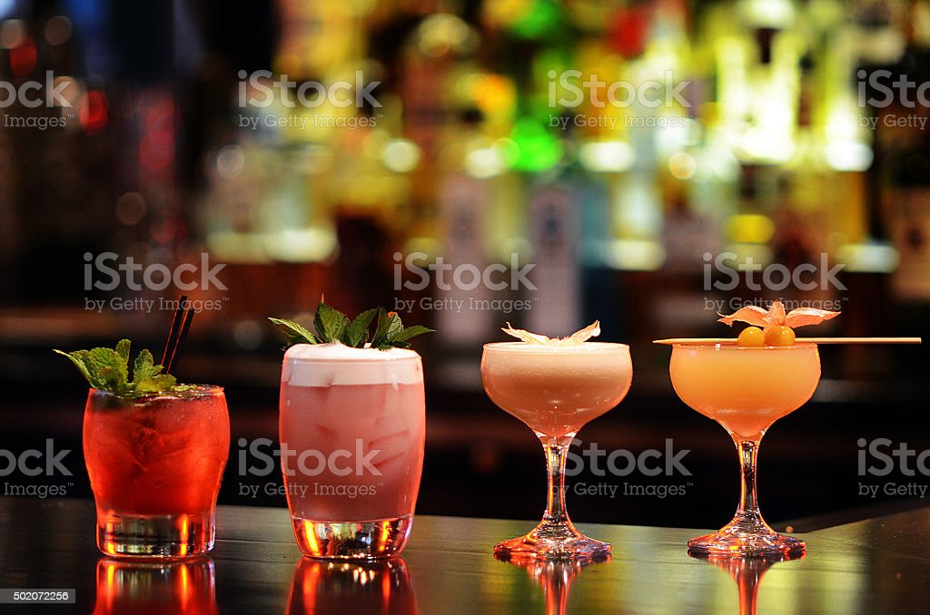 Craft Cocktail Assortment on Well Lit Bar stock photo