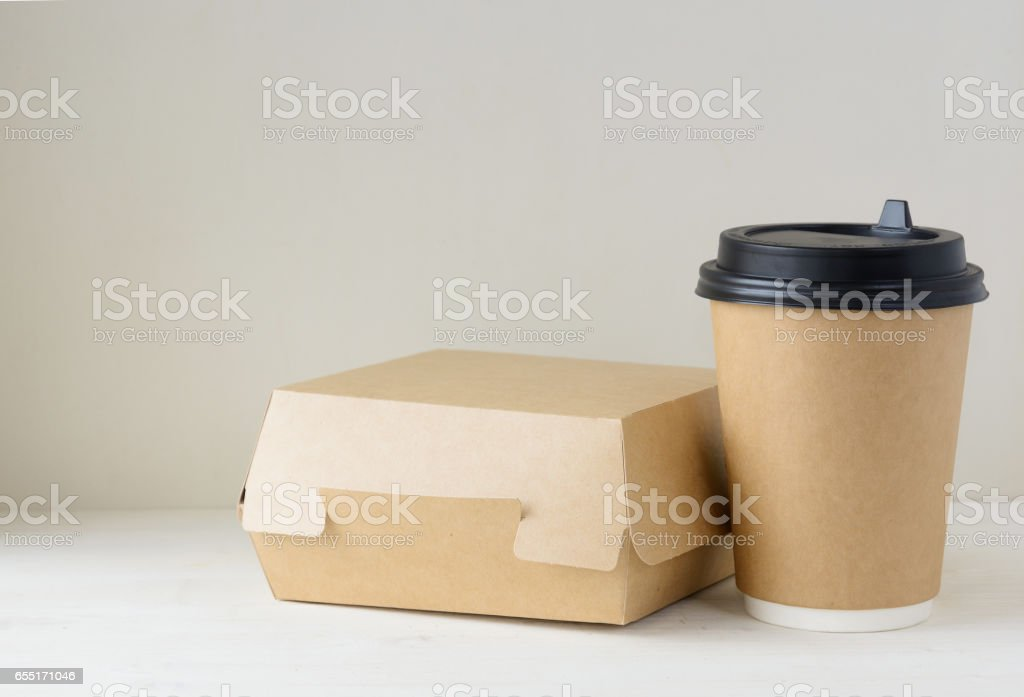 craft paper coffee cup and food box on the table stock photo