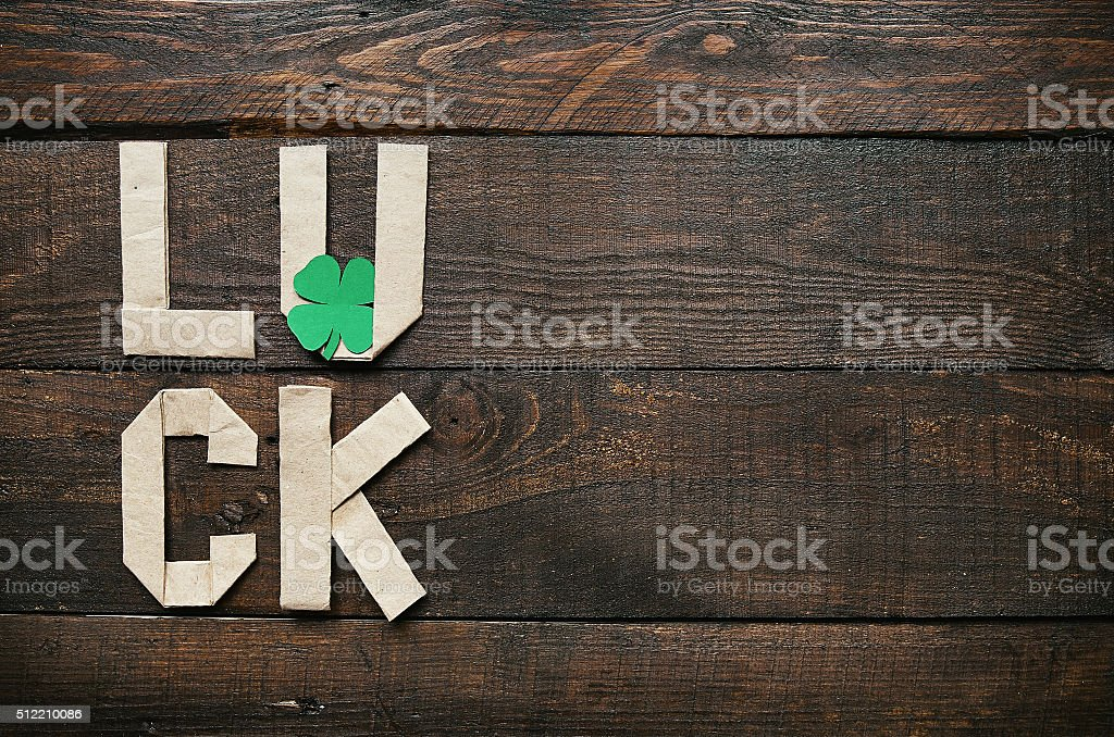 Craft paper origami LUCK lettering stock photo