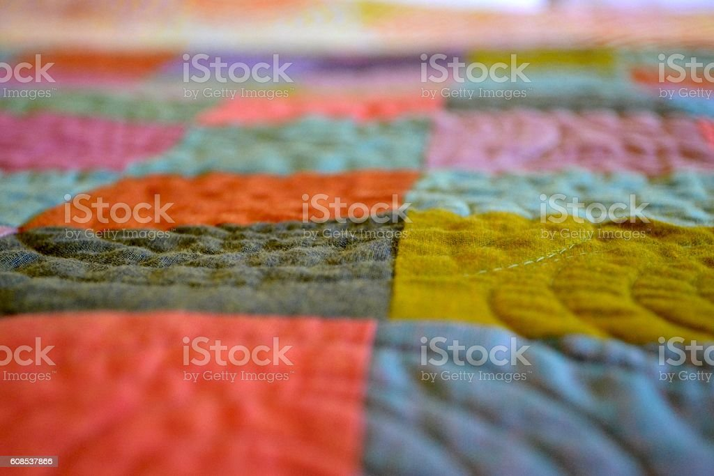 Craft quilt with spiral stitches stock photo