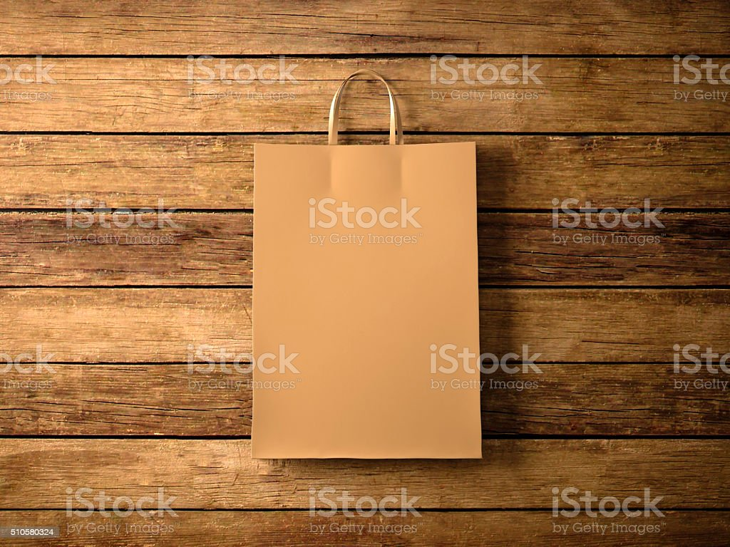 Craft shopping bag on the wooden background. In focus. Horizontal stock photo