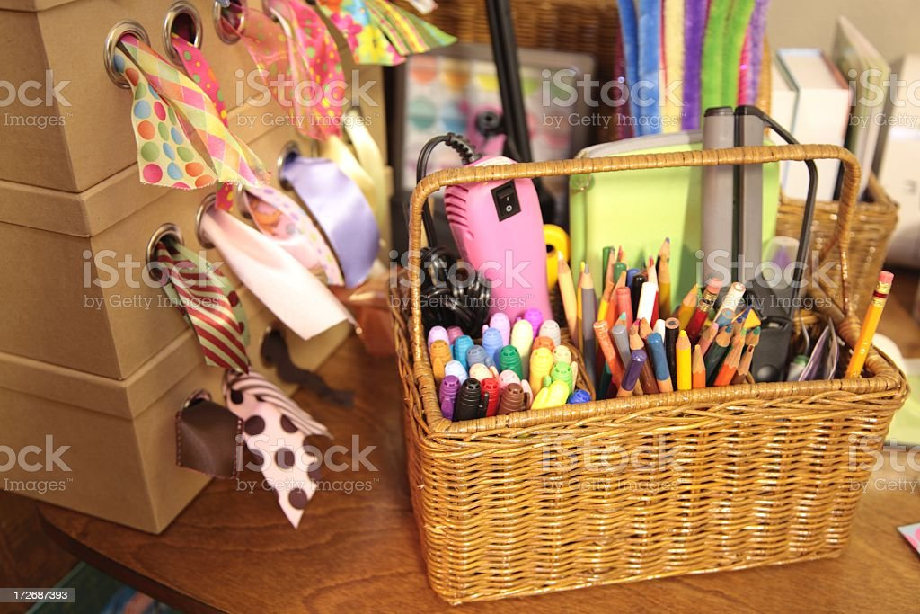 craft supplies with ribbon, markers, colored pencils in basket stock photo