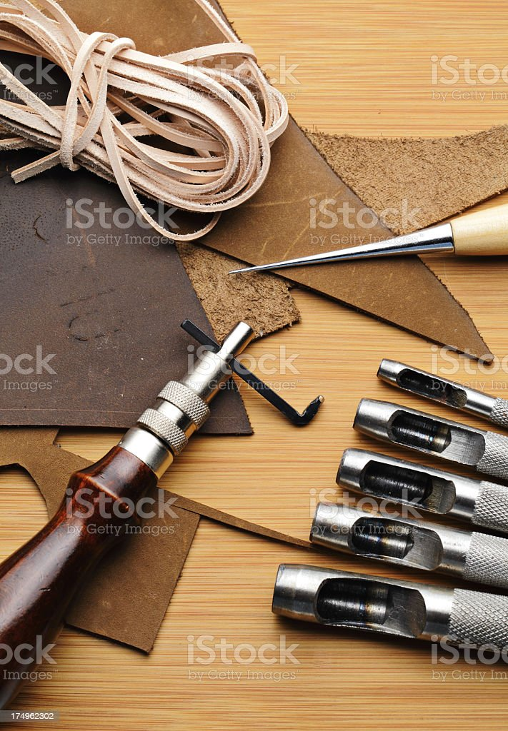 Craft tool with fragmented and stripe leather stock photo