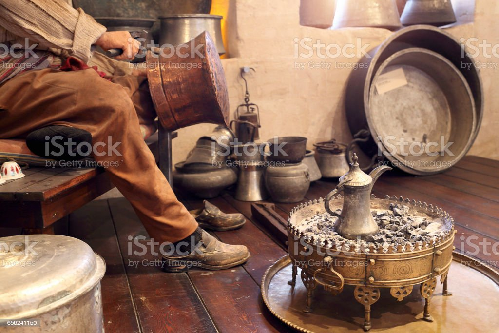 Craftman doing copper caldron, hand craft stock photo