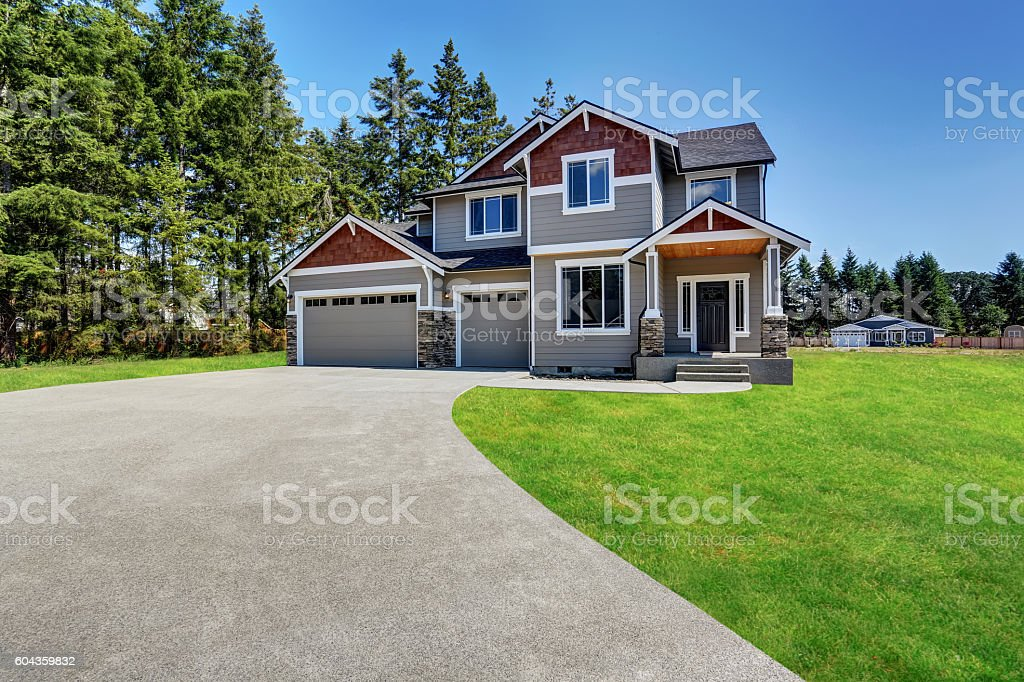 Craftsman American house with rocks trim, garage and porch stock photo