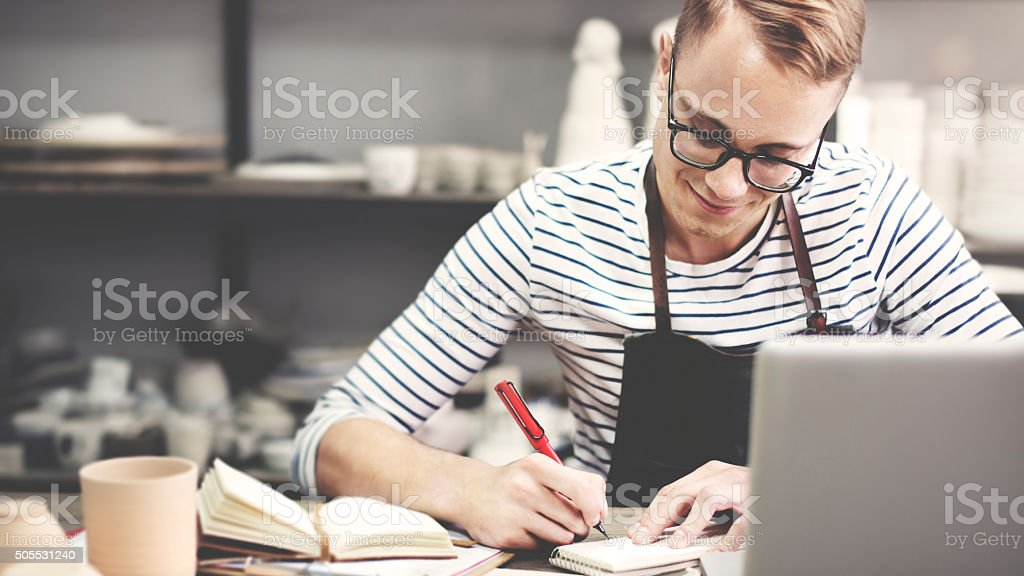 Craftsman Browsing Laptop Connection Technology Concept stock photo