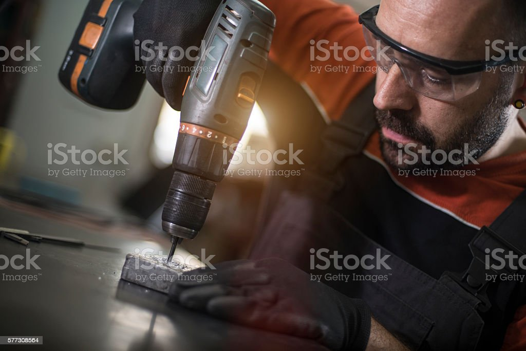 Craftsman dilling in his workshop stock photo