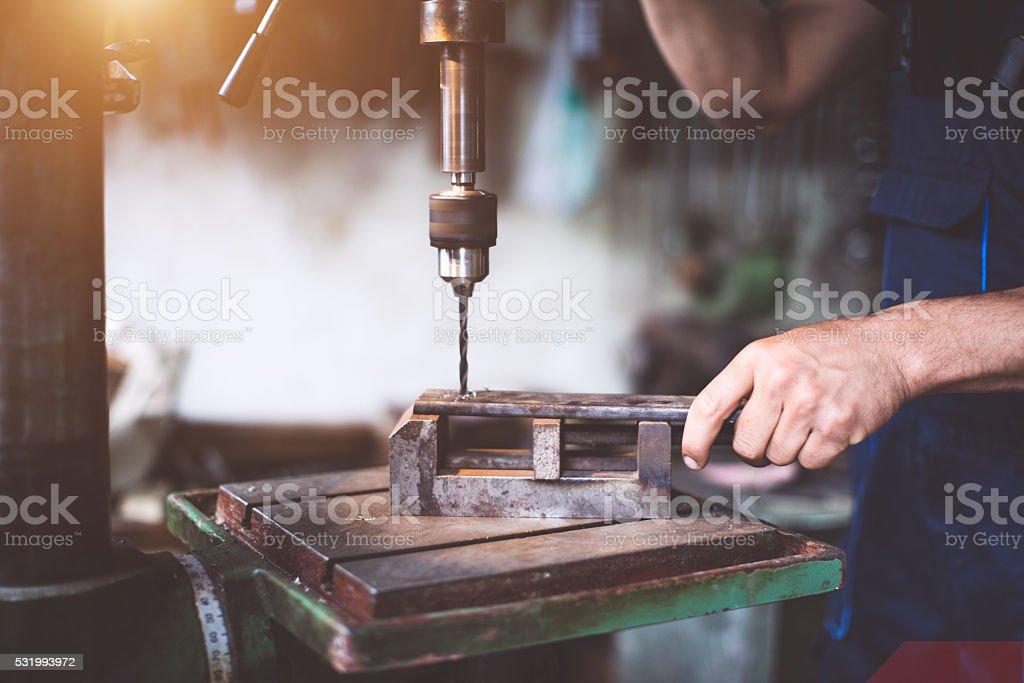 craftsman drilling metal stock photo