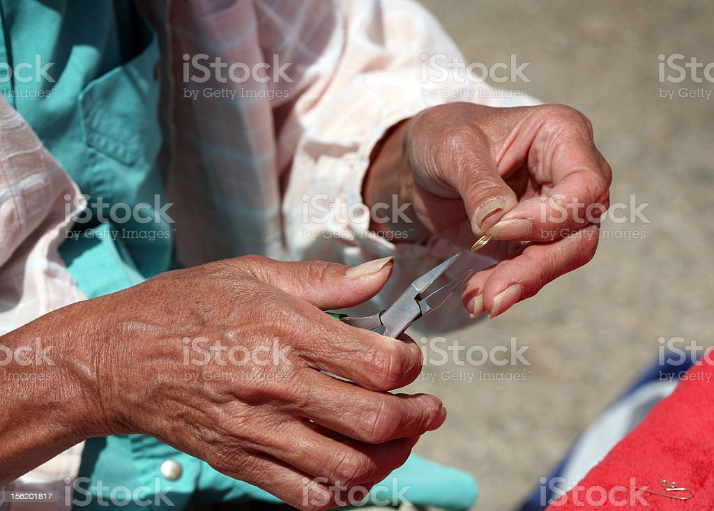 Craftsman hands making jewelry royalty-free stock photo