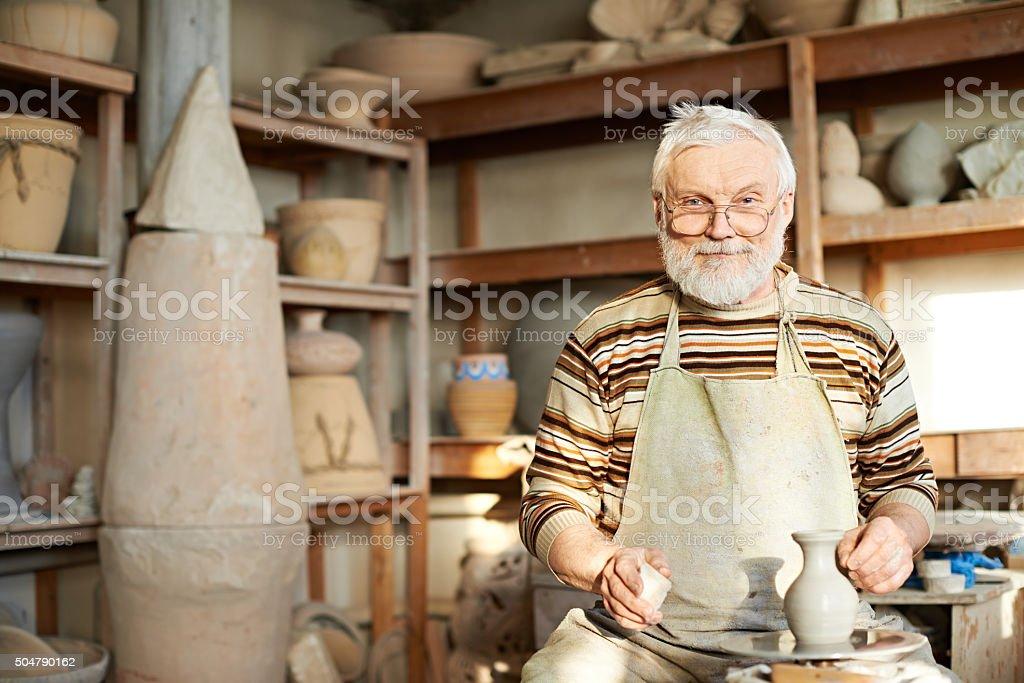 Craftsman in workshop stock photo
