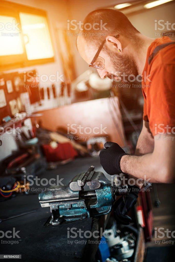 Craftsman machine piece and repairing stock photo