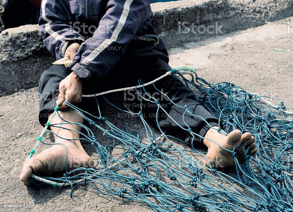 Craftsman Making A Fish Net, Da Nang, Vietnam stock photo