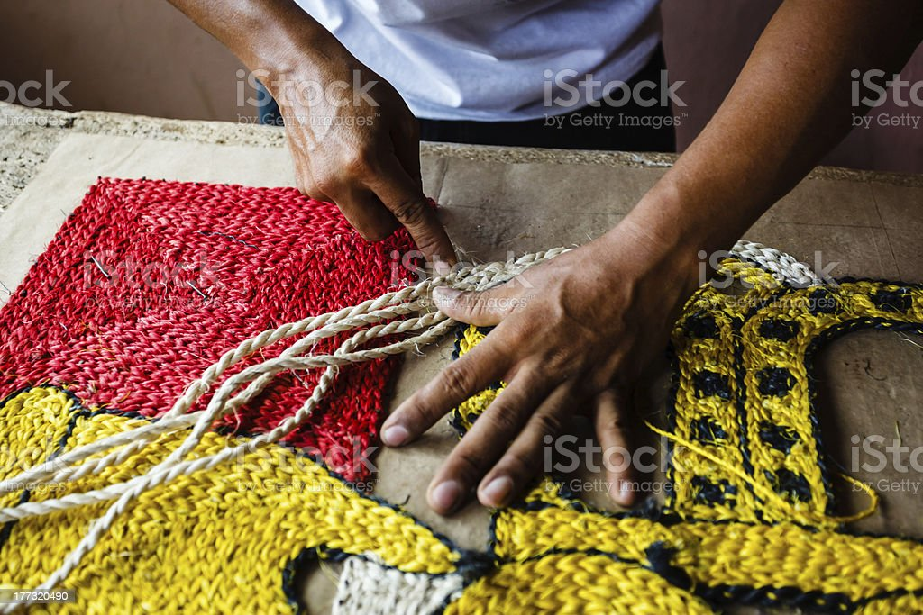 Craftsman making a rope rug or wall hanging stock photo