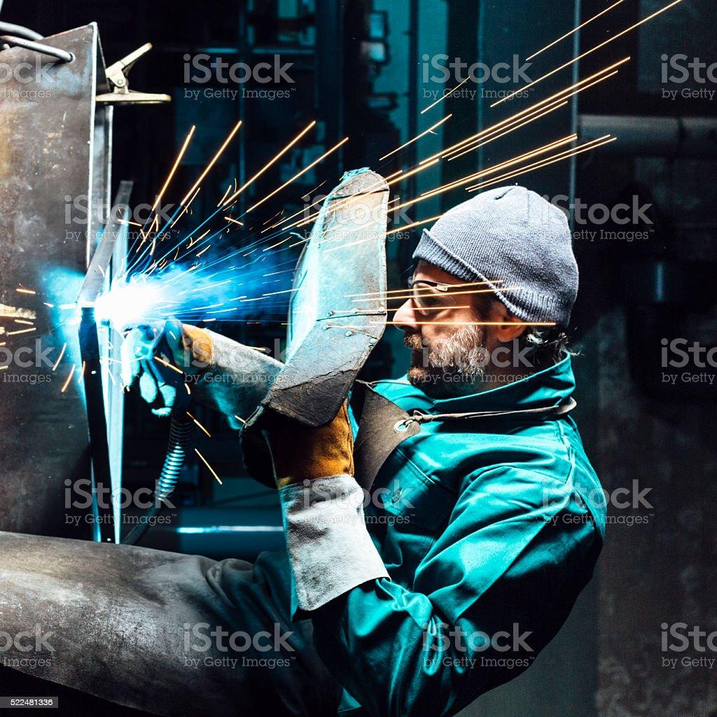 Craftsman repairman is working with welding machine torch stock photo