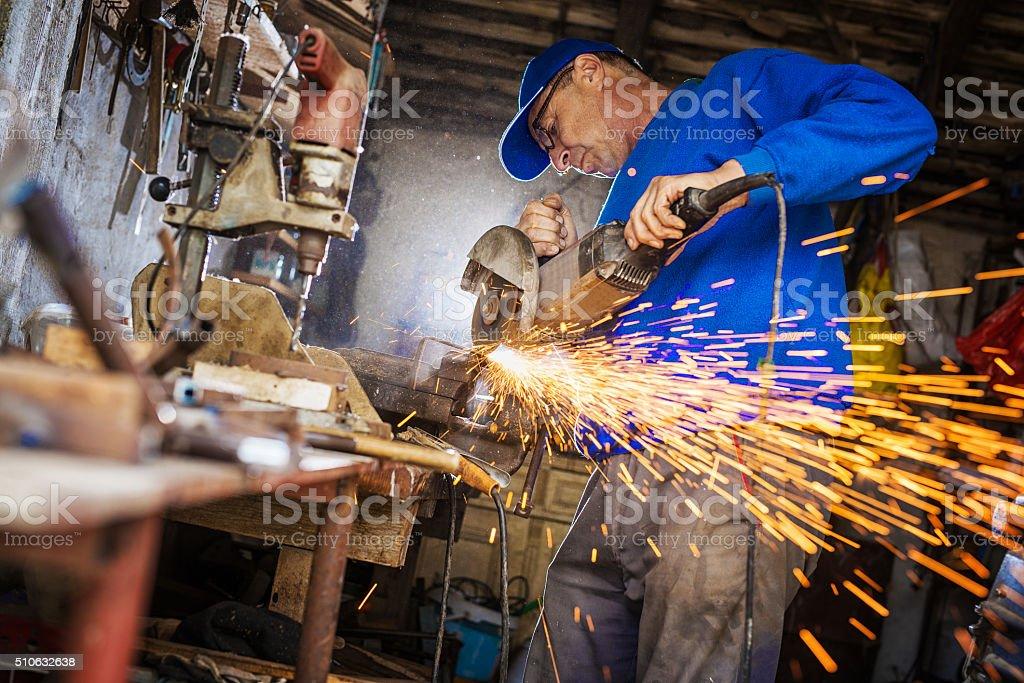Craftsman sawing metal. stock photo