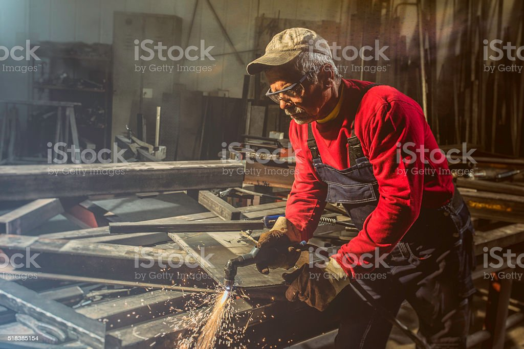 Craftsman welder at work in a small factory stock photo
