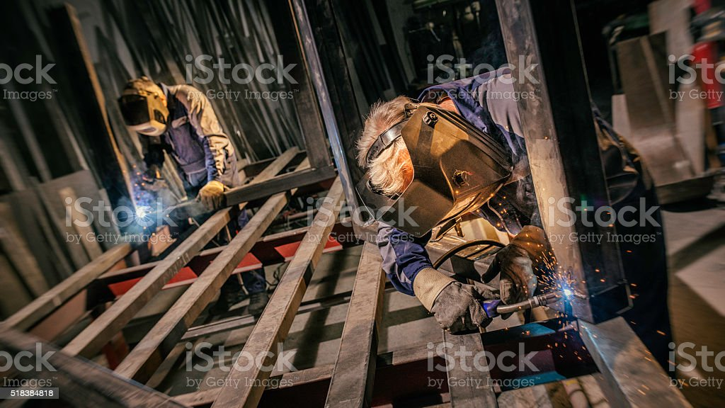 Craftsman welders at work in a small factory stock photo