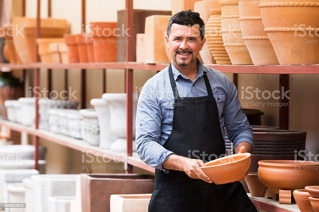 Craftsman with ceramic crockery stock photo