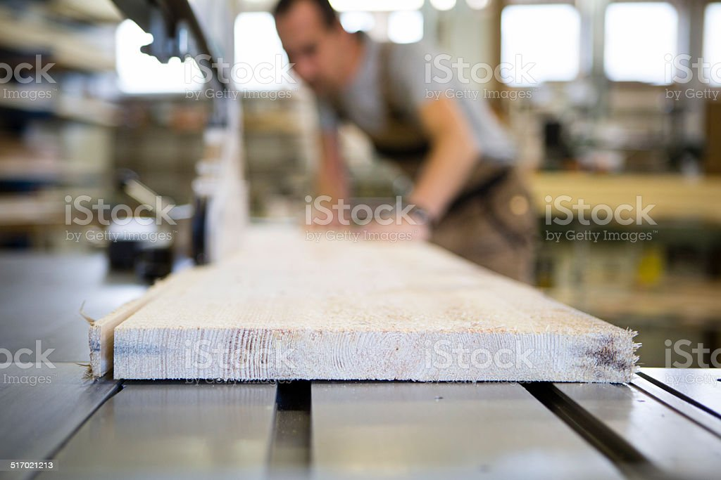 Craftsman working at Electric Saw stock photo