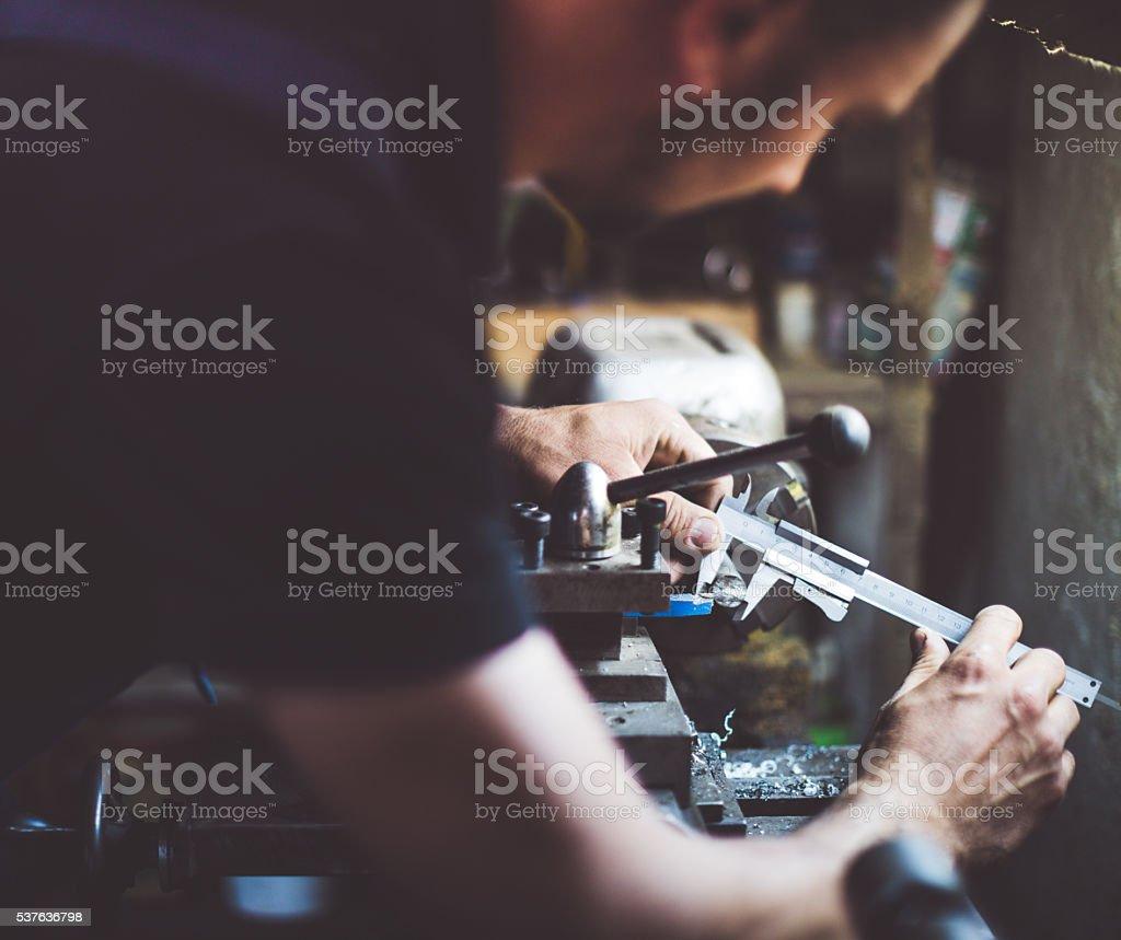 craftsman working in his workshop stock photo
