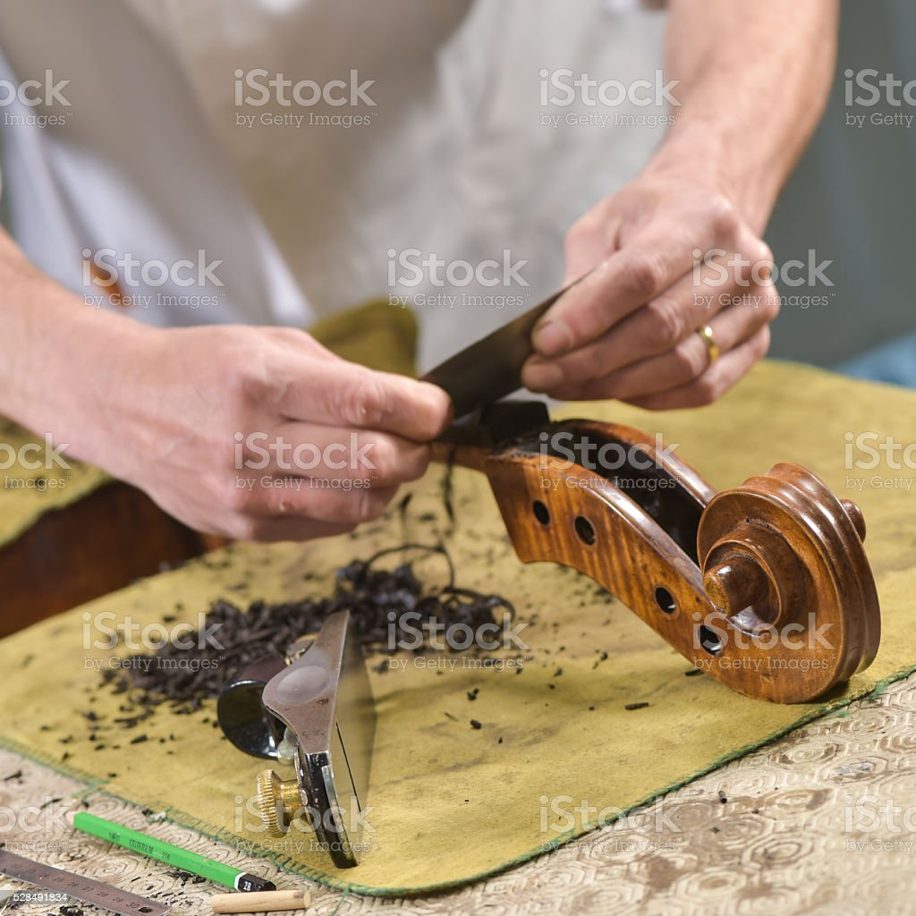 Craftsman working in workshop lutemaker stock photo