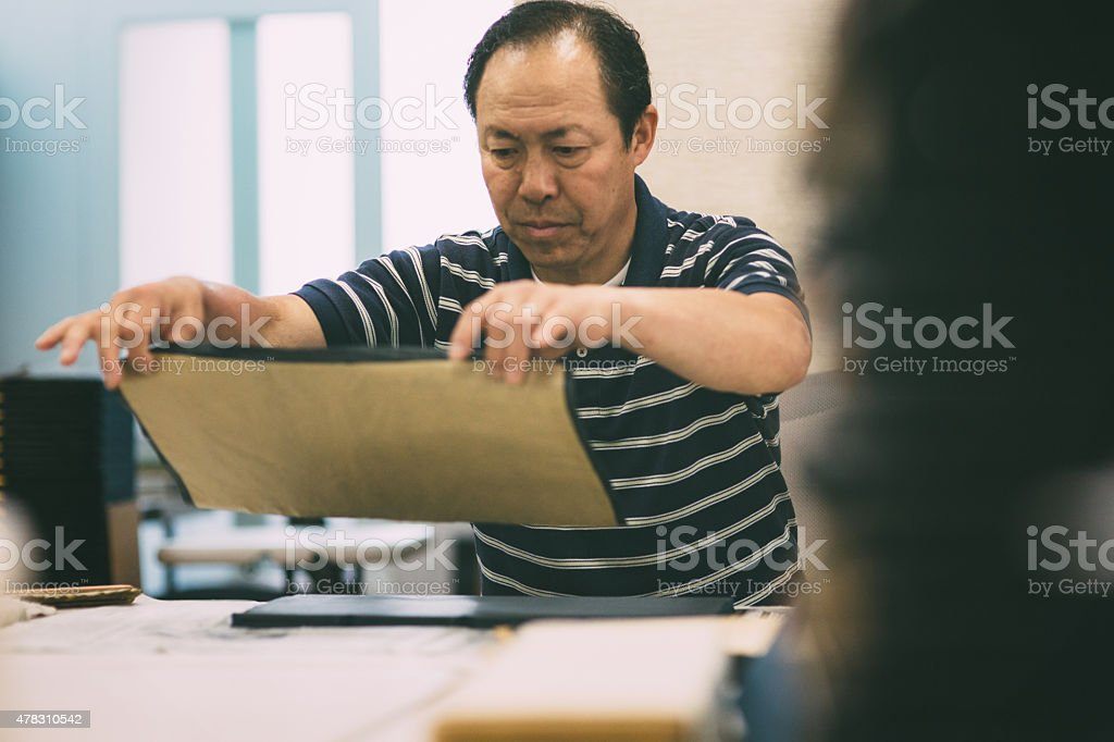 Craftsman works on art and craft product stock photo
