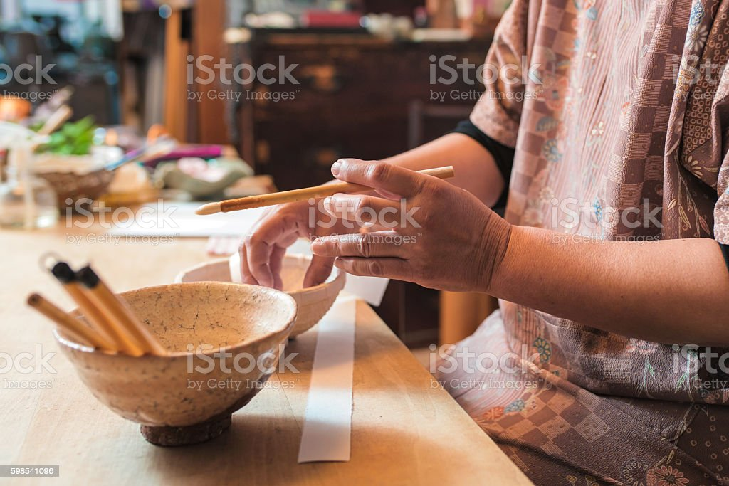 Craftsperson making a paper bowl stock photo